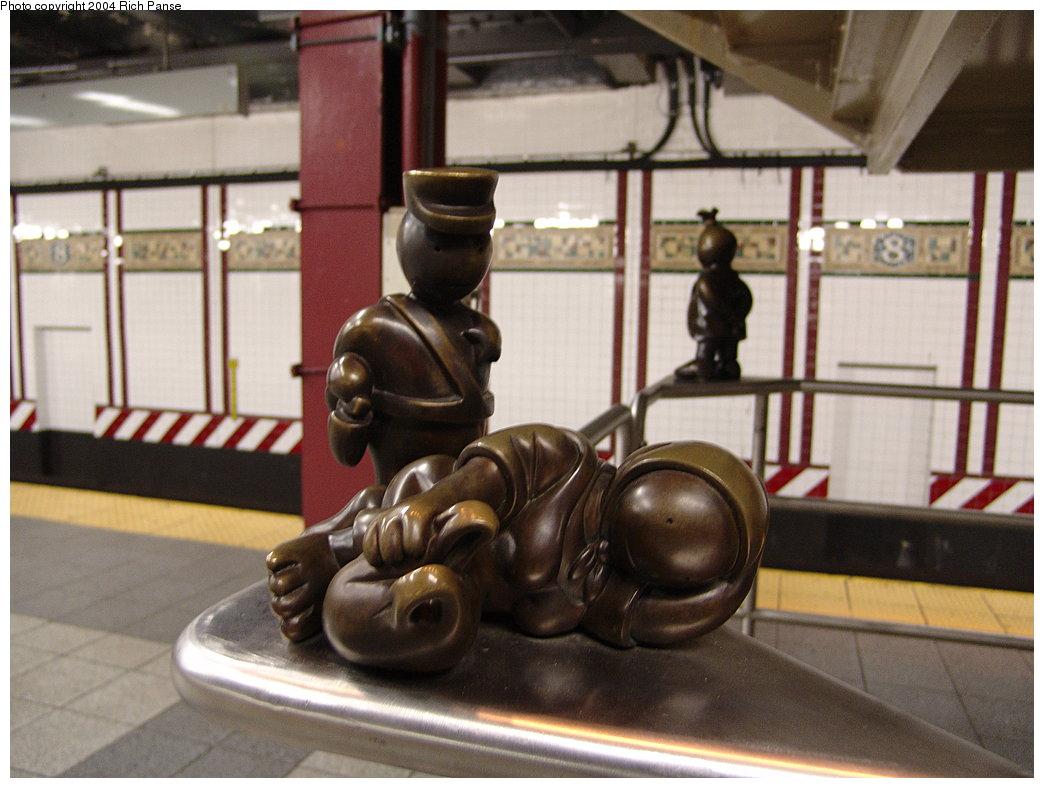 (164k, 1044x788)<br><b>Country:</b> United States<br><b>City:</b> New York<br><b>System:</b> New York City Transit<br><b>Line:</b> BMT Canarsie Line<br><b>Location:</b> 8th Avenue <br><b>Photo by:</b> Richard Panse<br><b>Date:</b> 12/15/2004<br><b>Artwork:</b> <i>Life Underground</i>, Tom Otterness (2000).<br><b>Viewed (this week/total):</b> 1 / 4477