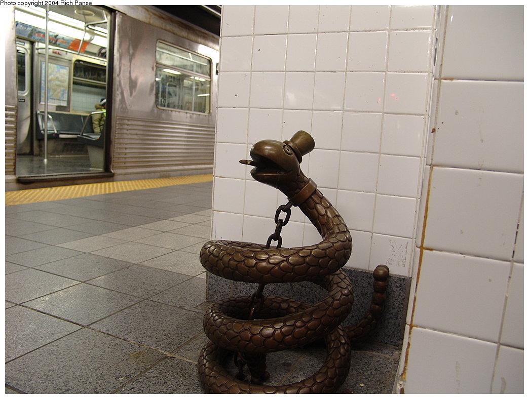 (170k, 1044x788)<br><b>Country:</b> United States<br><b>City:</b> New York<br><b>System:</b> New York City Transit<br><b>Line:</b> BMT Canarsie Line<br><b>Location:</b> 8th Avenue <br><b>Photo by:</b> Richard Panse<br><b>Date:</b> 12/15/2004<br><b>Artwork:</b> <i>Life Underground</i>, Tom Otterness (2000).<br><b>Viewed (this week/total):</b> 0 / 3972