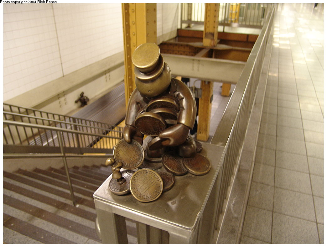 (164k, 1044x788)<br><b>Country:</b> United States<br><b>City:</b> New York<br><b>System:</b> New York City Transit<br><b>Line:</b> BMT Canarsie Line<br><b>Location:</b> 8th Avenue <br><b>Photo by:</b> Richard Panse<br><b>Date:</b> 12/15/2004<br><b>Artwork:</b> <i>Life Underground</i>, Tom Otterness (2000).<br><b>Viewed (this week/total):</b> 1 / 5535