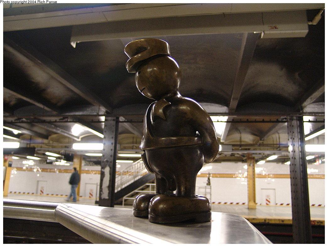 (184k, 1044x788)<br><b>Country:</b> United States<br><b>City:</b> New York<br><b>System:</b> New York City Transit<br><b>Line:</b> IND 8th Avenue Line<br><b>Location:</b> 14th Street <br><b>Photo by:</b> Richard Panse<br><b>Date:</b> 12/15/2004<br><b>Artwork:</b> <i>Life Underground</i>, Tom Otterness (2000).<br><b>Viewed (this week/total):</b> 3 / 3466