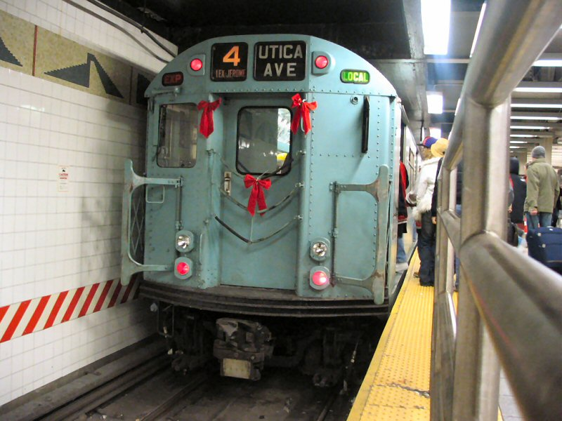 (102k, 800x600)<br><b>Country:</b> United States<br><b>City:</b> New York<br><b>System:</b> New York City Transit<br><b>Line:</b> IRT Times Square-Grand Central Shuttle<br><b>Location:</b> Grand Central <br><b>Route:</b> Fan Trip<br><b>Car:</b> R-33 World's Fair (St. Louis, 1963-64) 9306 <br><b>Photo by:</b> Dante D. Angerville<br><b>Date:</b> 12/18/2004<br><b>Notes:</b> Train in regular passenger service, technically not a fan trip.<br><b>Viewed (this week/total):</b> 0 / 3946