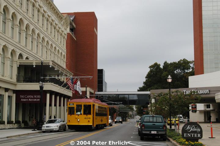 (141k, 720x478)<br><b>Country:</b> United States<br><b>City:</b> Little Rock, AR<br><b>System:</b> Little Rock CAT<br><b>Line:</b> Little Rock Loop<br><b>Location:</b> Markham/Capital Hotel <br><b>Car:</b>  409 <br><b>Photo by:</b> Peter Ehrlich<br><b>Date:</b> 11/14/2004<br><b>Notes:</b> Markham at the historic Capital Hotel.  The Hotel Peabody is on the right.<br><b>Viewed (this week/total):</b> 3 / 2705