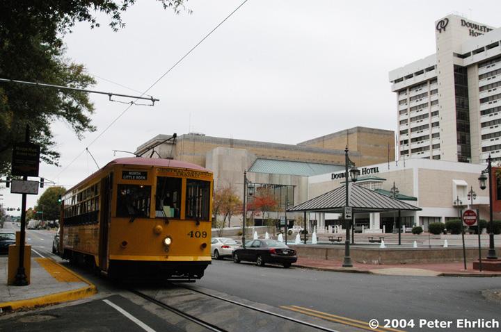 (147k, 720x478)<br><b>Country:</b> United States<br><b>City:</b> Little Rock, AR<br><b>System:</b> Little Rock CAT<br><b>Line:</b> Little Rock Loop<br><b>Location:</b> Markham/Center <br><b>Car:</b>  409 <br><b>Photo by:</b> Peter Ehrlich<br><b>Date:</b> 11/14/2004<br><b>Notes:</b> DoubleTree Hotel in the background.<br><b>Viewed (this week/total):</b> 2 / 2583