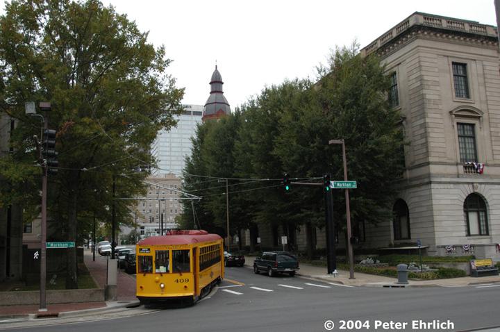 (154k, 720x478)<br><b>Country:</b> United States<br><b>City:</b> Little Rock, AR<br><b>System:</b> Little Rock CAT<br><b>Line:</b> Little Rock Loop<br><b>Location:</b> Spring/Markham <br><b>Car:</b>  409 <br><b>Photo by:</b> Peter Ehrlich<br><b>Date:</b> 11/14/2004<br><b>Notes:</b> The Arkansas Historical Museum is on the right.<br><b>Viewed (this week/total):</b> 3 / 2934