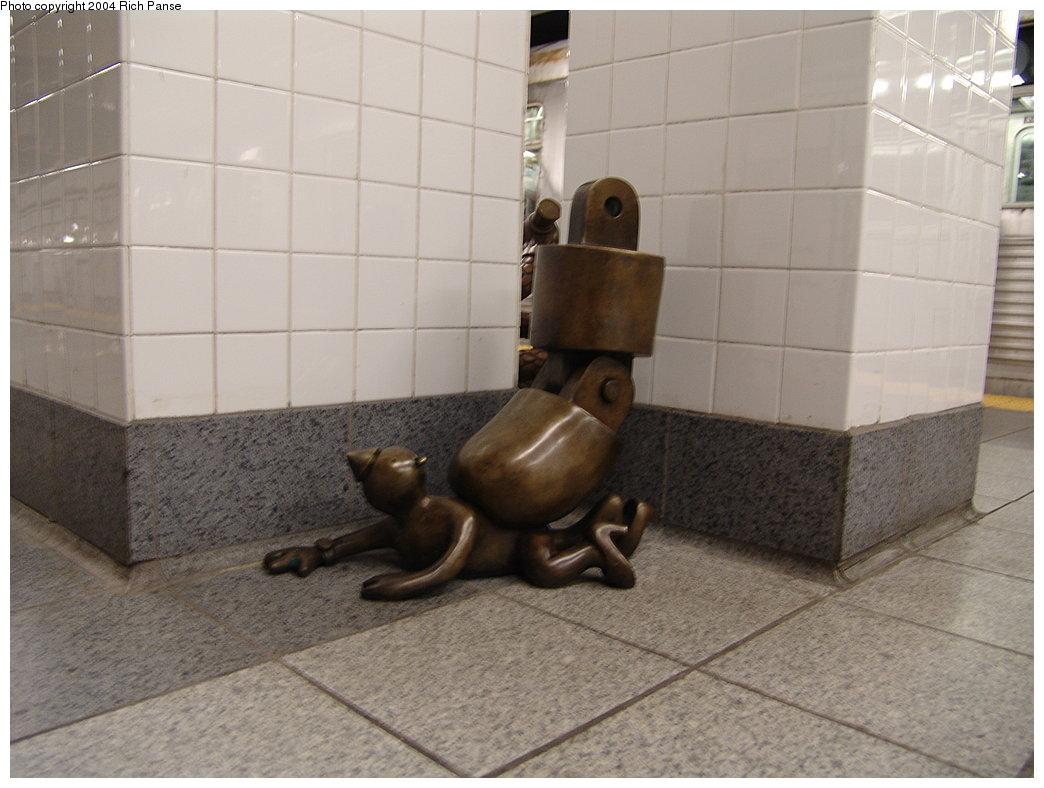 (152k, 1044x788)<br><b>Country:</b> United States<br><b>City:</b> New York<br><b>System:</b> New York City Transit<br><b>Line:</b> BMT Canarsie Line<br><b>Location:</b> 8th Avenue <br><b>Photo by:</b> Richard Panse<br><b>Date:</b> 12/15/2004<br><b>Artwork:</b> <i>Life Underground</i>, Tom Otterness (2000).<br><b>Viewed (this week/total):</b> 0 / 5913