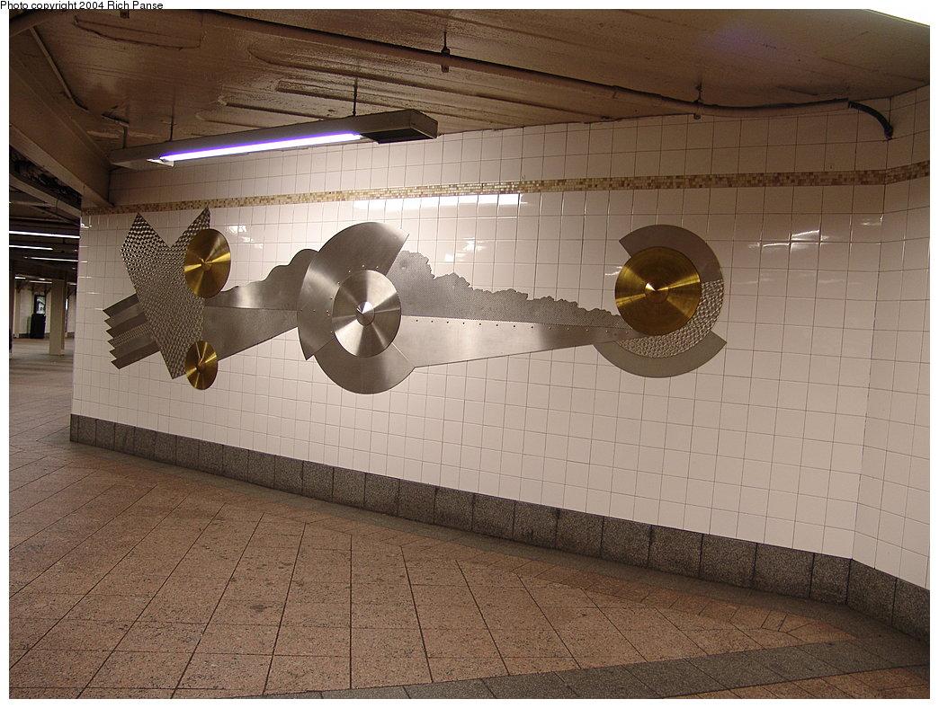 (196k, 1044x788)<br><b>Country:</b> United States<br><b>City:</b> New York<br><b>System:</b> New York City Transit<br><b>Line:</b> IRT Times Square-Grand Central Shuttle<br><b>Location:</b> Grand Central <br><b>Photo by:</b> Richard Panse<br><b>Date:</b> 12/19/2004<br><b>Artwork:</b> <i>Fast Track & Speed Wheels</i>, Dan Sinclair (1990).<br><b>Viewed (this week/total):</b> 1 / 3326