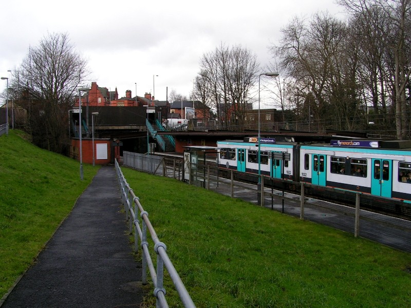 (162k, 800x600)<br><b>Country:</b> United Kingdom<br><b>City:</b> Manchester<br><b>System:</b> Metrolink <br><b>Line:</b> Bury line<br><b>Location:</b> Whitefield <br><b>Car:</b> Manchester T68 (Ansaldo-Breda, 1992)  1022 <br><b>Photo by:</b> Tim Deakin<br><b>Date:</b> 1/12/2005<br><b>Notes:</b> Tram #1022 at Whitefield, taken from the disabled ramp at the south end of the Bury platform.<br><b>Viewed (this week/total):</b> 3 / 2040