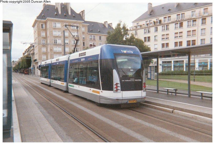 (115k, 820x553)<br><b>Country:</b> France<br><b>City:</b> Caen<br><b>System:</b> Compagnie des Transports de l'Agglomération Caennaise<br><b>Location:</b> Résistance<br><b>Photo by:</b> Duncan Allen<br><b>Date:</b> 6/30/2004<br><b>Notes:</b> Northbound tram leaving R&eacute;sistance station (urban).<br><b>Viewed (this week/total):</b> 1 / 8799