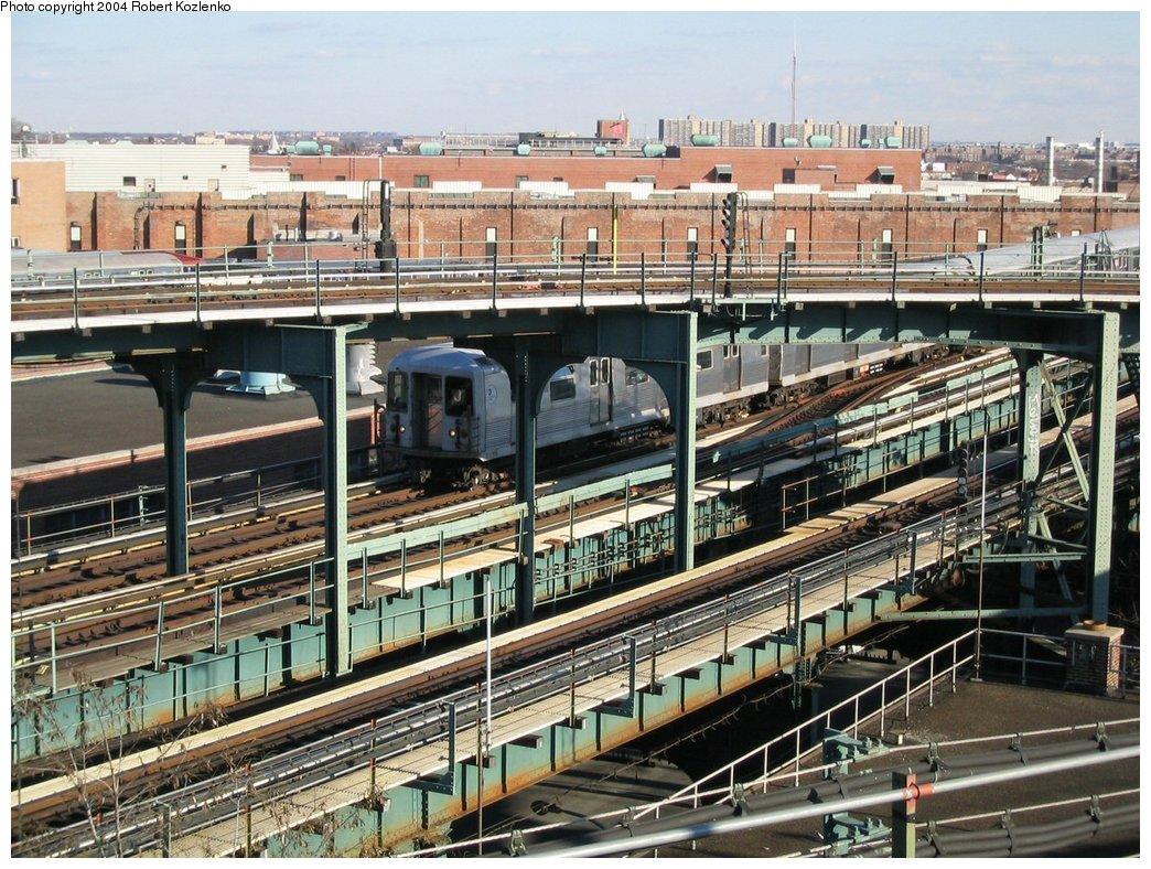 (249k, 1044x788)<br><b>Country:</b> United States<br><b>City:</b> New York<br><b>System:</b> New York City Transit<br><b>Line:</b> BMT Nassau Street/Jamaica Line<br><b>Location:</b> Broadway/East New York (Broadway Junction) <br><b>Route:</b> J<br><b>Car:</b> R-42 (St. Louis, 1969-1970)  4671 <br><b>Photo by:</b> Robert Kozlenko<br><b>Date:</b> 11/26/2004<br><b>Viewed (this week/total):</b> 0 / 4609