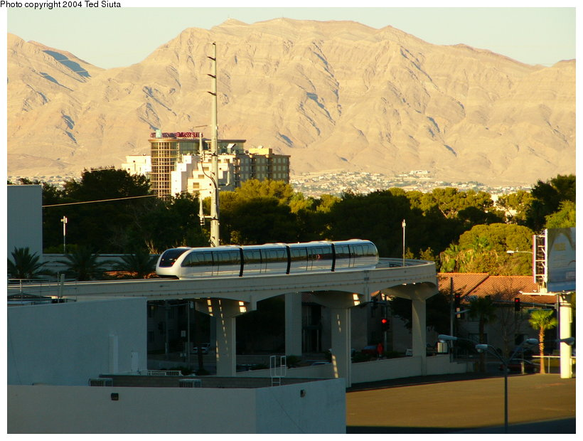 (122k, 820x620)<br><b>Country:</b> United States<br><b>City:</b> Las Vegas, NV<br><b>System:</b> Las Vegas Monorail<br><b>Location:</b> Las Vegas Convention Center <br><b>Photo by:</b> Ted Siuta<br><b>Date:</b> 8/27/2004<br><b>Notes:</b> Southbound monorail, on the east/west section having just left Convention Center station. This section strays the farthest from the Strip, as it reaches out to the Convention Center, and the Las Vegas Hilton.<br><b>Viewed (this week/total):</b> 0 / 3050