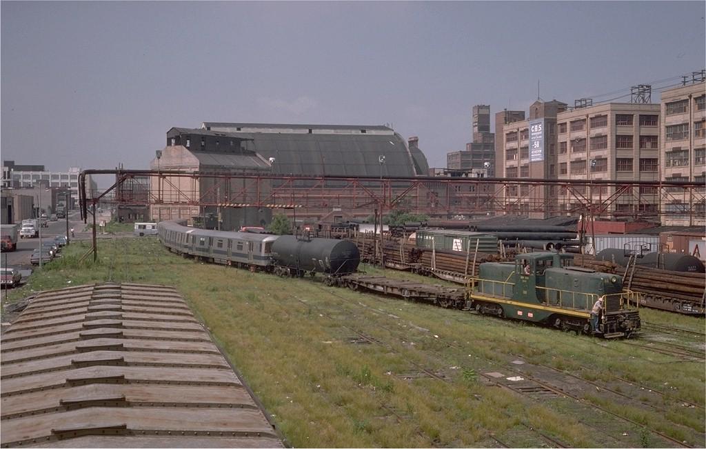 (187k, 1024x651)<br><b>Country:</b> United States<br><b>City:</b> New York<br><b>System:</b> New York City Transit<br><b>Line:</b> South Brooklyn Railway<br><b>Location:</b> 1st Ave/48th St.<br><b>Car:</b> R-46 (Pullman-Standard, 1974-75)  <br><b>Photo by:</b> Steve Zabel<br><b>Collection of:</b> Joe Testagrose<br><b>Date:</b> 6/27/1977<br><b>Notes:</b> R46 cars being delivered from car float terminal, New York Dock Railway.<br><b>Viewed (this week/total):</b> 0 / 6150