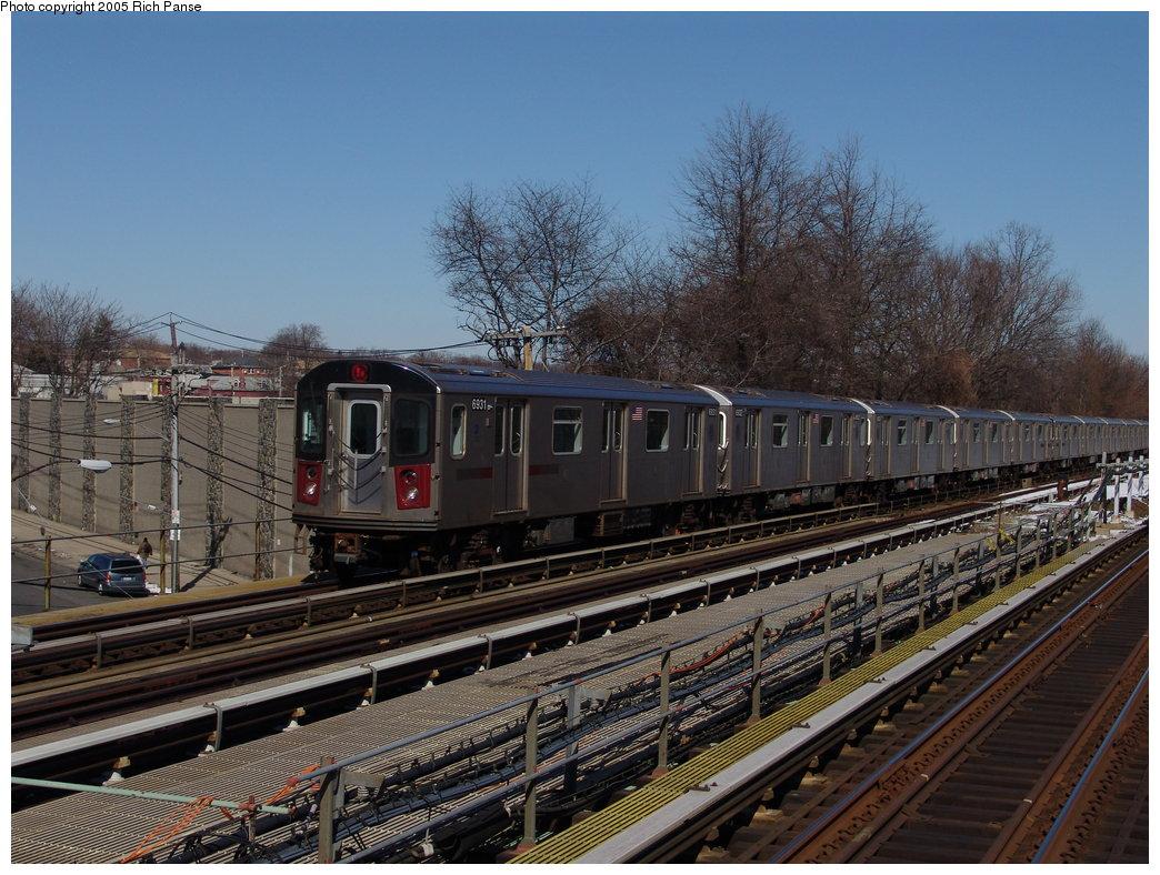(223k, 1044x788)<br><b>Country:</b> United States<br><b>City:</b> New York<br><b>System:</b> New York City Transit<br><b>Line:</b> IRT Dyre Ave. Line<br><b>Location:</b> Baychester Avenue <br><b>Route:</b> 5<br><b>Car:</b> R-142 (Primary Order, Bombardier, 1999-2002)  6931 <br><b>Photo by:</b> Richard Panse<br><b>Date:</b> 2/27/2005<br><b>Viewed (this week/total):</b> 2 / 4093