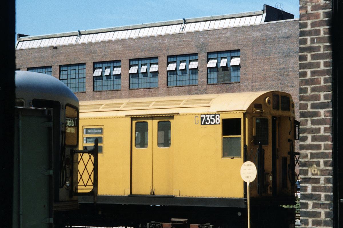 (364k, 1024x683)<br><b>Country:</b> United States<br><b>City:</b> New York<br><b>System:</b> New York City Transit<br><b>Location:</b> 207th Street Yard<br><b>Car:</b> Garbage Motor (R-21/R-22 Rebuilds)  G7358 <br><b>Photo by:</b> David Boone<br><b>Collection of:</b> David Pirmann<br><b>Date:</b> 8/26/1989<br><b>Viewed (this week/total):</b> 0 / 3438