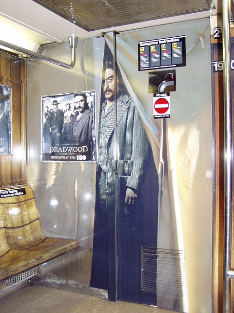 (130k, 480x640)<br><b>Country:</b> United States<br><b>City:</b> New York<br><b>System:</b> New York City Transit<br><b>Line:</b> IRT Times Square-Grand Central Shuttle<br><b>Location:</b> Grand Central <br><b>Route:</b> S<br><b>Car:</b> R-62A (Bombardier, 1984-1987)  1930 <br><b>Photo by:</b> Irwin Markowitz<br><b>Date:</b> 3/11/2005<br><b>Notes:</b> Car dressed up as a promotion for the HBO series <i>Deadwood</i>.<br><b>Viewed (this week/total):</b> 3 / 6088