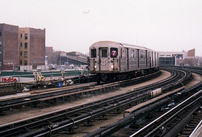 (225k, 795x541)<br><b>Country:</b> United States<br><b>City:</b> New York<br><b>System:</b> New York City Transit<br><b>Line:</b> IRT Flushing Line<br><b>Location:</b> 46th Street/Bliss Street <br><b>Route:</b> 7<br><b>Car:</b> R-62A (Bombardier, 1984-1987)  1676 <br><b>Photo by:</b> Gary Chatterton<br><b>Date:</b> 2/28/2005<br><b>Viewed (this week/total):</b> 1 / 2959