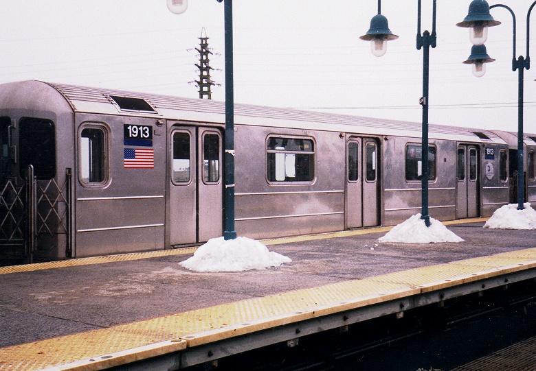 (200k, 780x541)<br><b>Country:</b> United States<br><b>City:</b> New York<br><b>System:</b> New York City Transit<br><b>Line:</b> IRT Flushing Line<br><b>Location:</b> 61st Street/Woodside <br><b>Route:</b> 7<br><b>Car:</b> R-62A (Bombardier, 1984-1987)  1913 <br><b>Photo by:</b> Gary Chatterton<br><b>Date:</b> 2/28/2005<br><b>Viewed (this week/total):</b> 0 / 2997