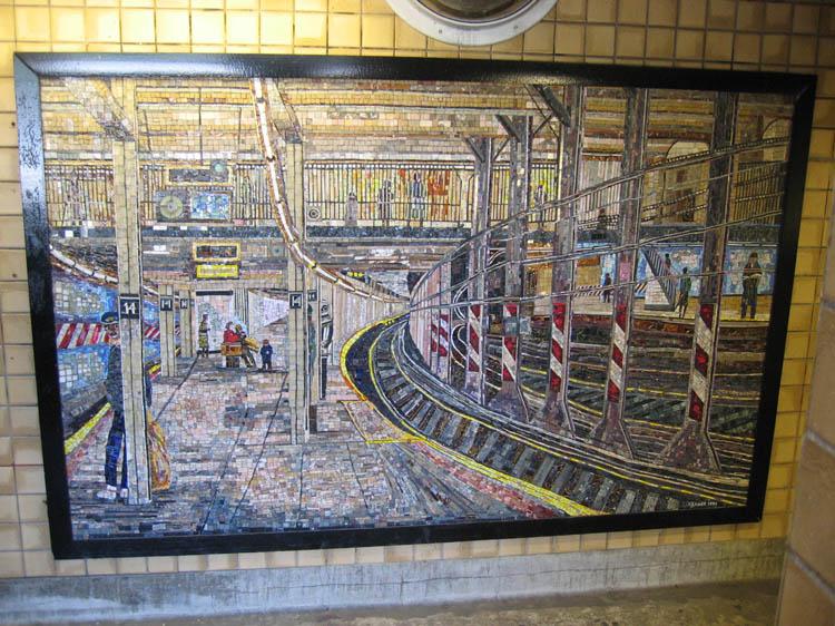 (137k, 750x562)<br><b>Country:</b> United States<br><b>City:</b> New York<br><b>System:</b> New York City Transit<br><b>Line:</b> IND 8th Avenue Line<br><b>Location:</b> Spring Street <br><b>Photo by:</b> Robbie Rosenfeld<br><b>Date:</b> 5/12/2005<br><b>Artwork:</b> <i>New York Subway Station</i>, Edith Kramer (1994).<br><b>Notes:</b> Artwork in northbound entrance stairway depicting 14th St./Union Sq. on the IRT.<br><b>Viewed (this week/total):</b> 4 / 6217