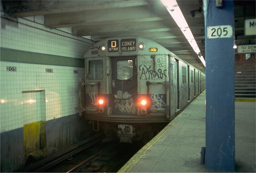(182k, 1024x691)<br><b>Country:</b> United States<br><b>City:</b> New York<br><b>System:</b> New York City Transit<br><b>Line:</b> IND Concourse Line<br><b>Location:</b> 205th Street <br><b>Route:</b> D<br><b>Car:</b> R-27 (St. Louis, 1960)  8212 <br><b>Photo by:</b> Doug Grotjahn<br><b>Collection of:</b> Joe Testagrose<br><b>Date:</b> 2/11/1978<br><b>Viewed (this week/total):</b> 1 / 5706