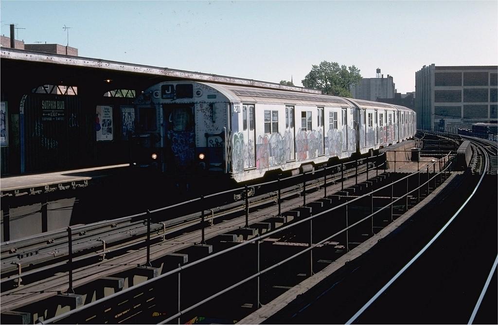 (176k, 1024x668)<br><b>Country:</b> United States<br><b>City:</b> New York<br><b>System:</b> New York City Transit<br><b>Line:</b> BMT Nassau Street/Jamaica Line<br><b>Location:</b> Sutphin Boulevard (Demolished) <br><b>Route:</b> J<br><b>Car:</b> R-30 (St. Louis, 1961) 8277 <br><b>Photo by:</b> Doug Grotjahn<br><b>Collection of:</b> Joe Testagrose<br><b>Date:</b> 9/9/1977<br><b>Viewed (this week/total):</b> 0 / 4425