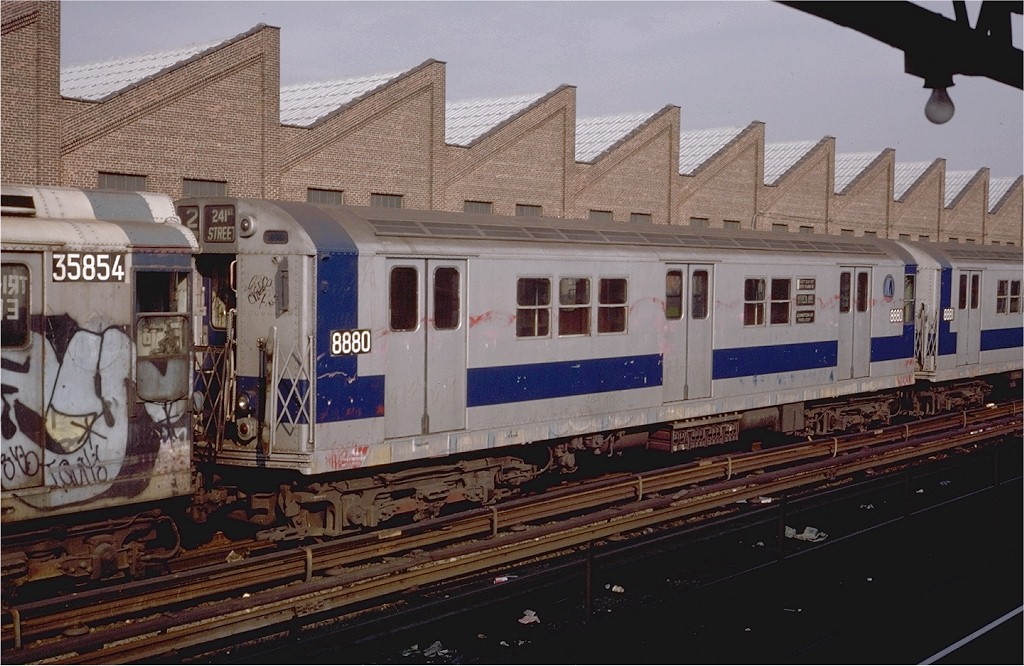 (203k, 1024x666)<br><b>Country:</b> United States<br><b>City:</b> New York<br><b>System:</b> New York City Transit<br><b>Location:</b> East 180th Street Yard<br><b>Car:</b> R-33 Main Line (St. Louis, 1962-63) 8880 <br><b>Photo by:</b> Steve Zabel<br><b>Collection of:</b> Joe Testagrose<br><b>Date:</b> 11/24/1979<br><b>Viewed (this week/total):</b> 6 / 3812