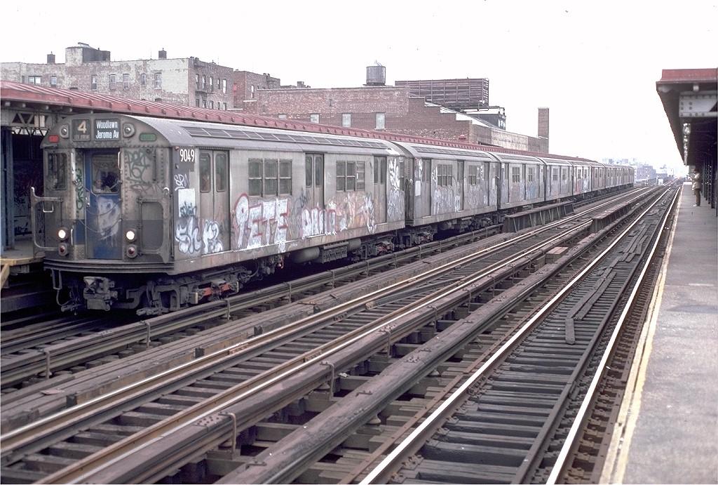 (235k, 1024x691)<br><b>Country:</b> United States<br><b>City:</b> New York<br><b>System:</b> New York City Transit<br><b>Line:</b> IRT Woodlawn Line<br><b>Location:</b> 167th Street <br><b>Route:</b> 4<br><b>Car:</b> R-33 Main Line (St. Louis, 1962-63) 9049 <br><b>Photo by:</b> Doug Grotjahn<br><b>Collection of:</b> Joe Testagrose<br><b>Date:</b> 11/28/1982<br><b>Viewed (this week/total):</b> 2 / 4992