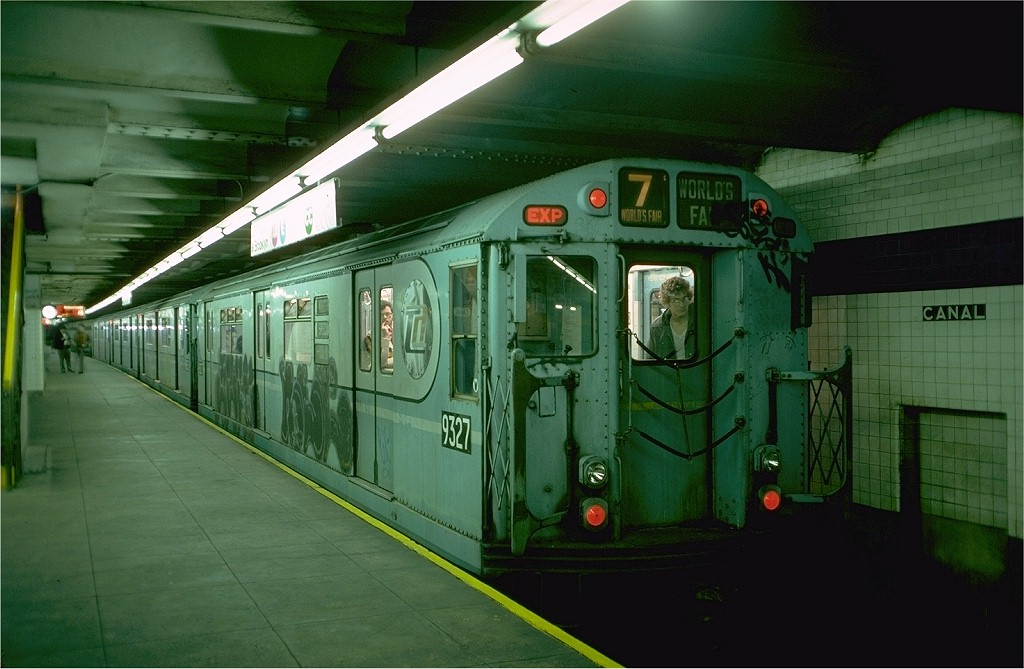 (173k, 1024x669)<br><b>Country:</b> United States<br><b>City:</b> New York<br><b>System:</b> New York City Transit<br><b>Line:</b> IND 8th Avenue Line<br><b>Location:</b> Canal Street-Holland Tunnel <br><b>Route:</b> Fan Trip<br><b>Car:</b> R-33 World's Fair (St. Louis, 1963-64) 9327 <br><b>Photo by:</b> Doug Grotjahn<br><b>Collection of:</b> Joe Testagrose<br><b>Date:</b> 11/27/1976<br><b>Viewed (this week/total):</b> 2 / 3949