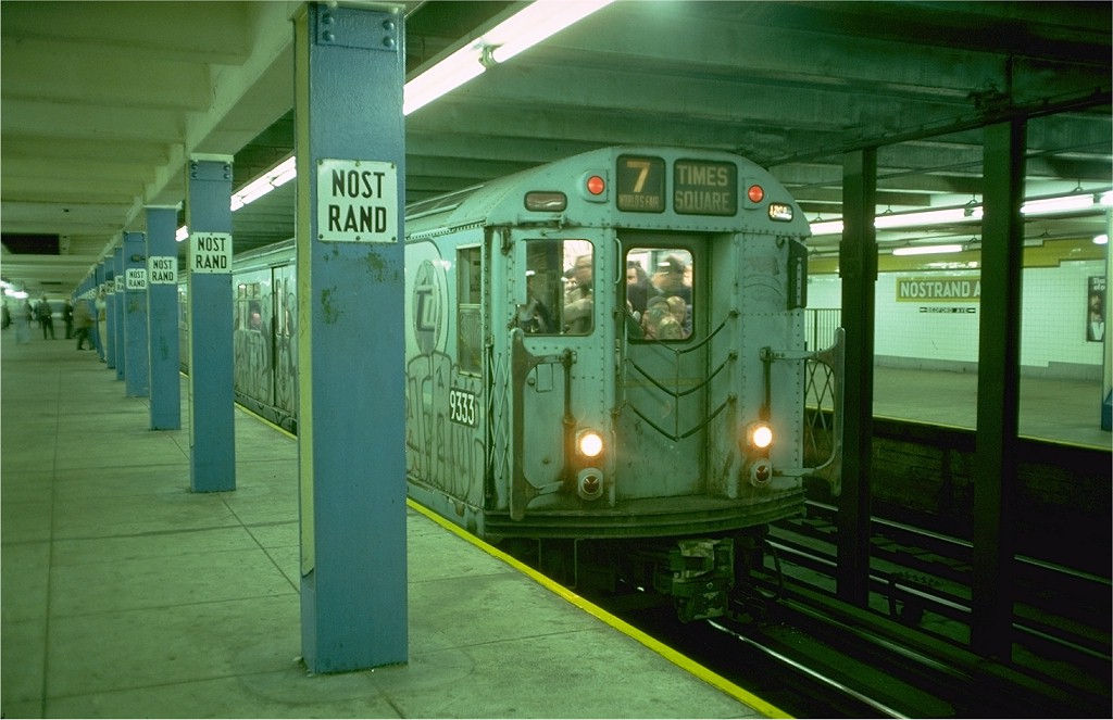 (165k, 1024x663)<br><b>Country:</b> United States<br><b>City:</b> New York<br><b>System:</b> New York City Transit<br><b>Line:</b> IND Fulton Street Line<br><b>Location:</b> Nostrand Avenue <br><b>Route:</b> Fan Trip<br><b>Car:</b> R-33 World's Fair (St. Louis, 1963-64) 9333 <br><b>Photo by:</b> Doug Grotjahn<br><b>Collection of:</b> Joe Testagrose<br><b>Date:</b> 11/27/1976<br><b>Notes:</b> Upper level.<br><b>Viewed (this week/total):</b> 0 / 4847