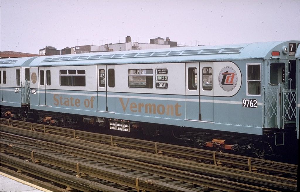 (192k, 1024x656)<br><b>Country:</b> United States<br><b>City:</b> New York<br><b>System:</b> New York City Transit<br><b>Line:</b> IRT Flushing Line<br><b>Location:</b> 82nd Street/Jackson Heights <br><b>Route:</b> 7<br><b>Car:</b> R-36 World's Fair (St. Louis, 1963-64) 9762 <br><b>Photo by:</b> Willie Rosenberg<br><b>Collection of:</b> Joe Testagrose<br><b>Date:</b> 3/1965<br><b>Notes:</b> <i>State of Vermont</i> car.<br><b>Viewed (this week/total):</b> 6 / 2922