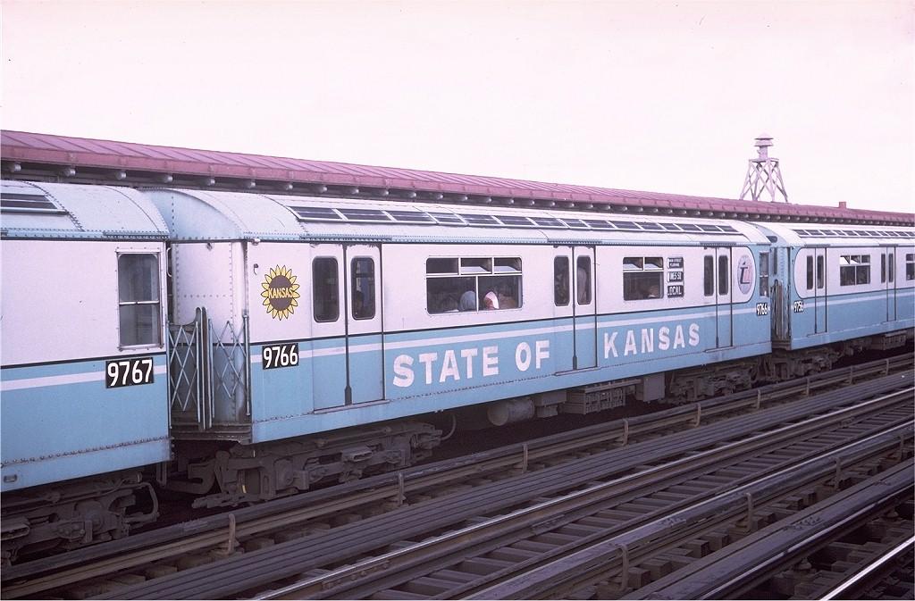 (189k, 1024x673)<br><b>Country:</b> United States<br><b>City:</b> New York<br><b>System:</b> New York City Transit<br><b>Line:</b> IRT Flushing Line<br><b>Location:</b> 103rd Street/Corona Plaza <br><b>Route:</b> 7<br><b>Car:</b> R-36 World's Fair (St. Louis, 1963-64) 9766 <br><b>Photo by:</b> Doug Grotjahn<br><b>Collection of:</b> Joe Testagrose<br><b>Date:</b> 12/6/1970<br><b>Viewed (this week/total):</b> 0 / 3913