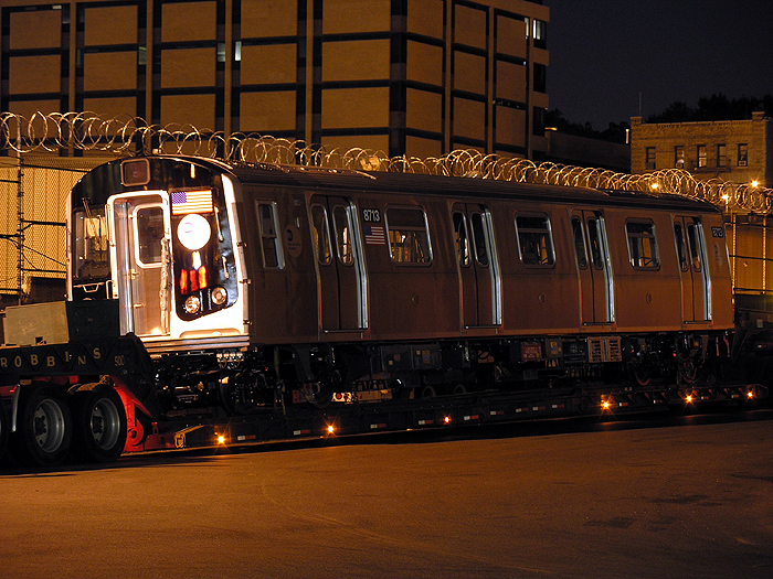 (472k, 700x525)<br><b>Country:</b> United States<br><b>City:</b> New York<br><b>System:</b> New York City Transit<br><b>Location:</b> 207th Street Yard<br><b>Car:</b> R-160B (Kawasaki, 2005-2008)  8713 <br><b>Photo by:</b> Trevor Logan<br><b>Date:</b> 7/20/2005<br><b>Notes:</b> First R160 being delivered. Photo courtesy TransiTalk Media Group.<br><b>Viewed (this week/total):</b> 0 / 10613