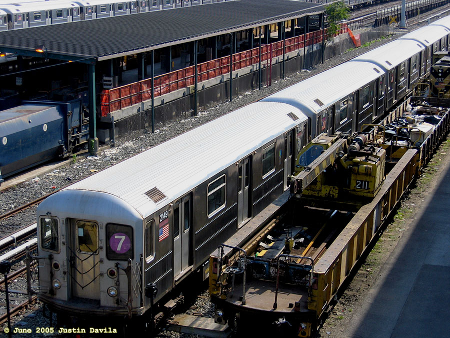 (251k, 900x675)<br><b>Country:</b> United States<br><b>City:</b> New York<br><b>System:</b> New York City Transit<br><b>Location:</b> Corona Yard<br><b>Car:</b> R-62A (Bombardier, 1984-1987)  2149 <br><b>Photo by:</b> Justin Davila<br><b>Date:</b> 6/8/2005<br><b>Notes:</b> With Crane Car 211.<br><b>Viewed (this week/total):</b> 0 / 2816