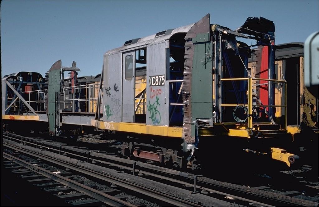 (195k, 1024x667)<br><b>Country:</b> United States<br><b>City:</b> New York<br><b>System:</b> New York City Transit<br><b>Location:</b> 207th Street Yard<br><b>Car:</b> R-12 (American Car & Foundry, 1948) XC875 (ex-5781)<br><b>Photo by:</b> Steve Zabel<br><b>Collection of:</b> Joe Testagrose<br><b>Date:</b> 4/1976<br><b>Viewed (this week/total):</b> 0 / 2600