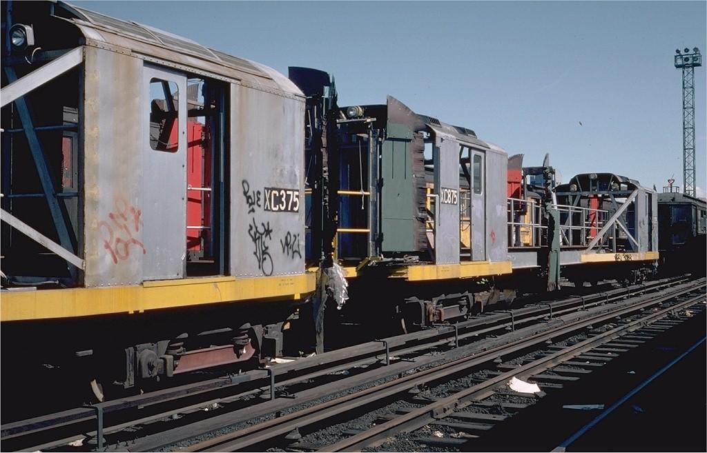 (185k, 1024x657)<br><b>Country:</b> United States<br><b>City:</b> New York<br><b>System:</b> New York City Transit<br><b>Location:</b> 207th Street Yard<br><b>Car:</b> R-12 (American Car & Foundry, 1948) XC875 (ex-5781)<br><b>Photo by:</b> Steve Zabel<br><b>Collection of:</b> Joe Testagrose<br><b>Date:</b> 4/1976<br><b>Viewed (this week/total):</b> 0 / 2811