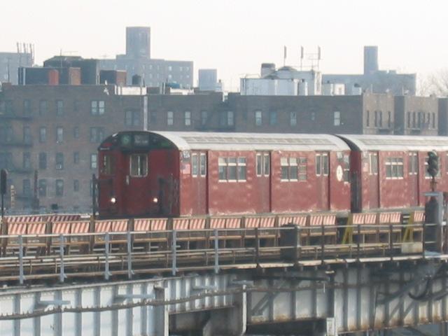 (93k, 640x480)<br><b>Country:</b> United States<br><b>City:</b> New York<br><b>System:</b> New York City Transit<br><b>Line:</b> IRT White Plains Road Line<br><b>Location:</b> West Farms Sq./East Tremont Ave./177th St. <br><b>Route:</b> 5<br><b>Car:</b> R-33 Main Line (St. Louis, 1962-63) 9104 <br><b>Photo by:</b> Oren H.<br><b>Date:</b> 11/29/2002<br><b>Viewed (this week/total):</b> 1 / 3483