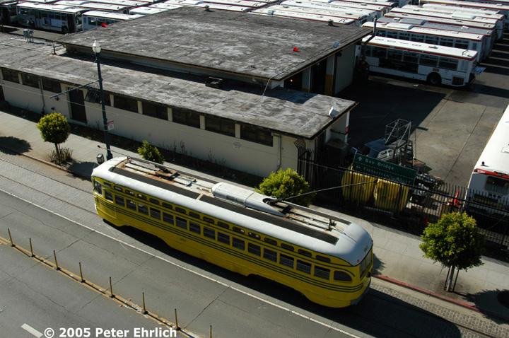 (177k, 720x478)<br><b>Country:</b> United States<br><b>City:</b> San Francisco/Bay Area, CA<br><b>System:</b> SF MUNI<br><b>Location:</b> Beach/Powell <br><b>Car:</b> SF MUNI PCC (Ex-SEPTA) (St. Louis Car Co., 1947-1948)  1057 <br><b>Photo by:</b> Peter Ehrlich<br><b>Date:</b> 6/19/2005<br><b>Notes:</b> Beach/Powell outbound, view from top floor of Pier 39 garage, showing Kirkland bus yard.<br><b>Viewed (this week/total):</b> 1 / 517
