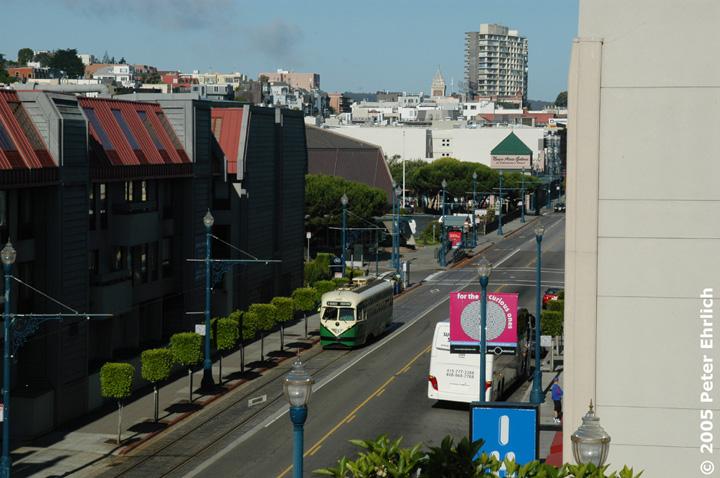 (141k, 720x478)<br><b>Country:</b> United States<br><b>City:</b> San Francisco/Bay Area, CA<br><b>System:</b> SF MUNI<br><b>Location:</b> Beach/Mason <br><b>Car:</b> SF MUNI PCC (Ex-SEPTA) (St. Louis Car Co., 1947-1948)  1062 <br><b>Photo by:</b> Peter Ehrlich<br><b>Date:</b> 6/19/2005<br><b>Notes:</b> At Beach/Mason outbound, view west from 4th floor of Pier 39 garage.<br><b>Viewed (this week/total):</b> 0 / 585