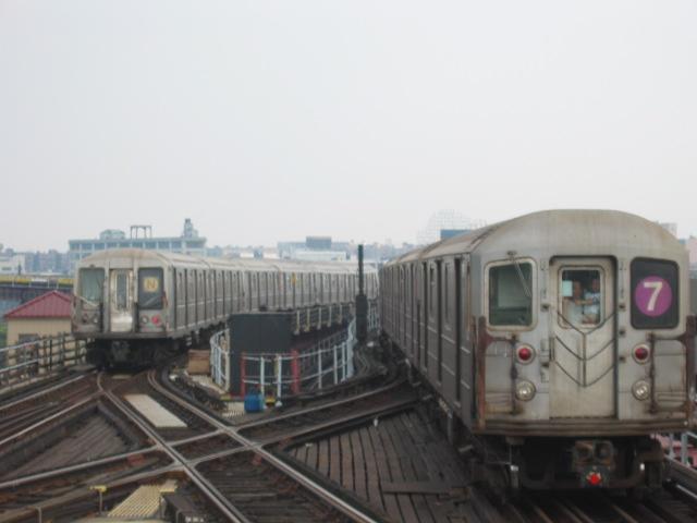 (67k, 640x480)<br><b>Country:</b> United States<br><b>City:</b> New York<br><b>System:</b> New York City Transit<br><b>Line:</b> BMT Astoria Line<br><b>Location:</b> Queensborough Plaza <br><b>Route:</b> N<br><b>Car:</b> R-40 (St. Louis, 1968)   <br><b>Photo by:</b> Oren H.<br><b>Date:</b> 6/27/2003<br><b>Notes:</b> w/R62A on #7 leaving Queensboro Plaza<br><b>Viewed (this week/total):</b> 2 / 5082