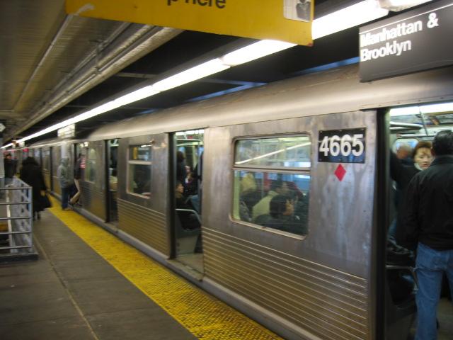 (103k, 640x480)<br><b>Country:</b> United States<br><b>City:</b> New York<br><b>System:</b> New York City Transit<br><b>Line:</b> BMT Astoria Line<br><b>Location:</b> Queensborough Plaza <br><b>Route:</b> N<br><b>Car:</b> R-42 (St. Louis, 1969-1970)  4665 <br><b>Photo by:</b> Oren H.<br><b>Date:</b> 11/29/2002<br><b>Notes:</b> Coupled to R42 4665-lost their mates in the Williamsburg Bridge collision.<br><b>Viewed (this week/total):</b> 1 / 3873