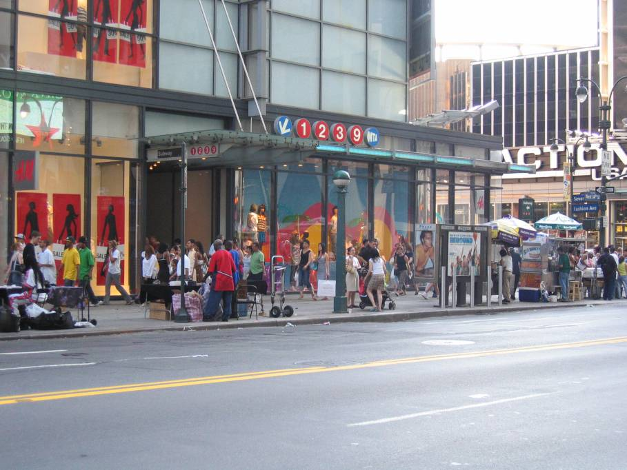 (97k, 909x682)<br><b>Country:</b> United States<br><b>City:</b> New York<br><b>System:</b> New York City Transit<br><b>Line:</b> IRT West Side Line<br><b>Location:</b> 34th Street/Penn Station <br><b>Photo by:</b> Robbie Rosenfeld<br><b>Date:</b> 7/10/2005<br><b>Notes:</b> Station entrance, NE corner 34th & 7th.<br><b>Viewed (this week/total):</b> 1 / 4263
