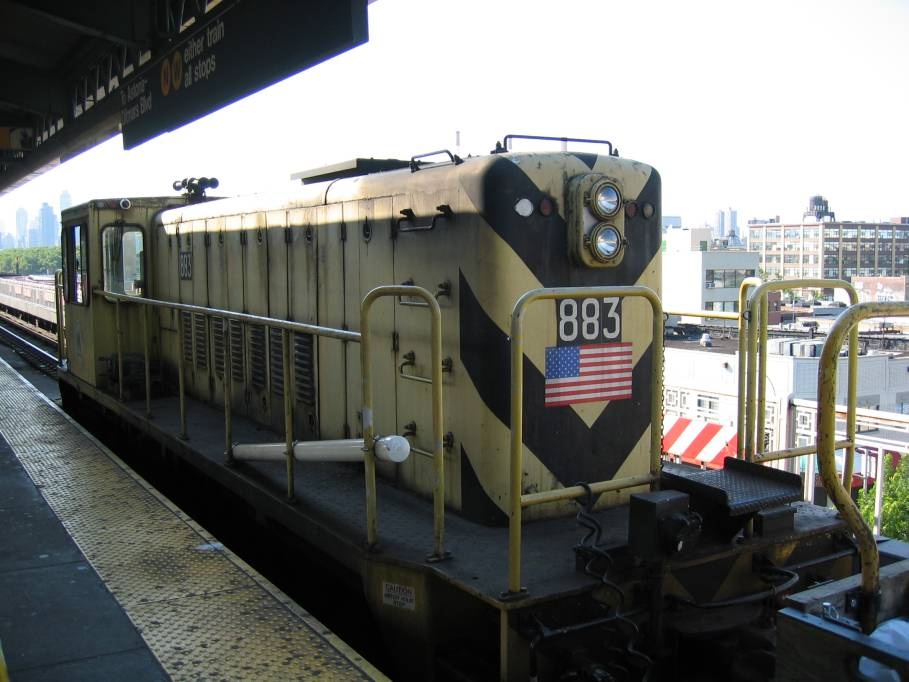 (81k, 909x682)<br><b>Country:</b> United States<br><b>City:</b> New York<br><b>System:</b> New York City Transit<br><b>Line:</b> BMT Astoria Line<br><b>Location:</b> Queensborough Plaza <br><b>Car:</b> R-77 Locomotive  883 <br><b>Photo by:</b> Robbie Rosenfeld<br><b>Date:</b> 7/10/2005<br><b>Viewed (this week/total):</b> 4 / 3341