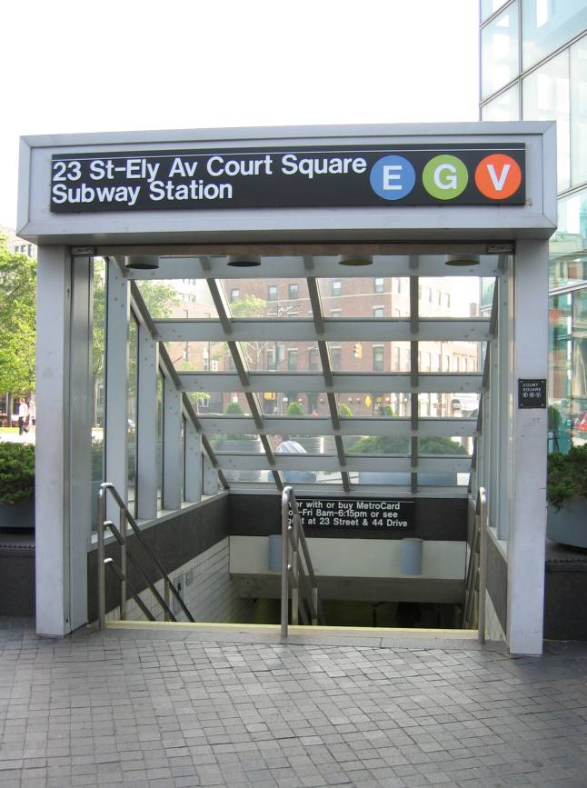 (78k, 646x867)<br><b>Country:</b> United States<br><b>City:</b> New York<br><b>System:</b> New York City Transit<br><b>Line:</b> IND Queens Boulevard Line<br><b>Location:</b> Court Square/23rd St (Ely Avenue) <br><b>Photo by:</b> Robbie Rosenfeld<br><b>Date:</b> 7/11/2005<br><b>Notes:</b> Station entrance.<br><b>Viewed (this week/total):</b> 1 / 5732