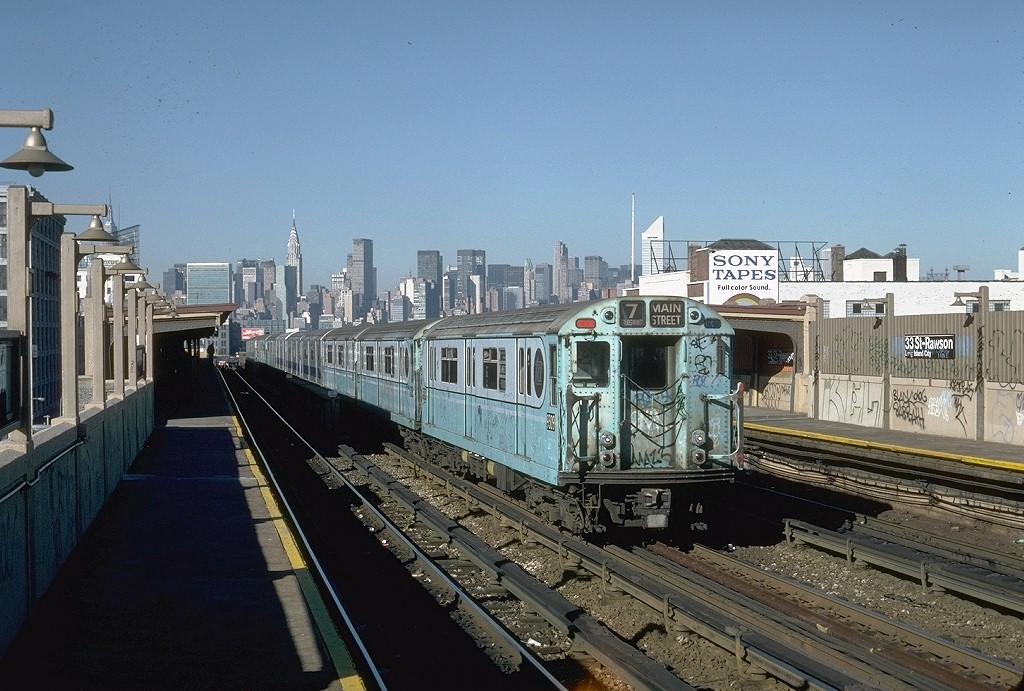 (216k, 1024x691)<br><b>Country:</b> United States<br><b>City:</b> New York<br><b>System:</b> New York City Transit<br><b>Line:</b> IRT Flushing Line<br><b>Location:</b> 33rd Street/Rawson Street <br><b>Route:</b> 7<br><b>Car:</b> R-33 World's Fair (St. Louis, 1963-64) 9309 <br><b>Photo by:</b> Steve Zabel<br><b>Collection of:</b> Joe Testagrose<br><b>Date:</b> 11/3/1981<br><b>Viewed (this week/total):</b> 0 / 4368