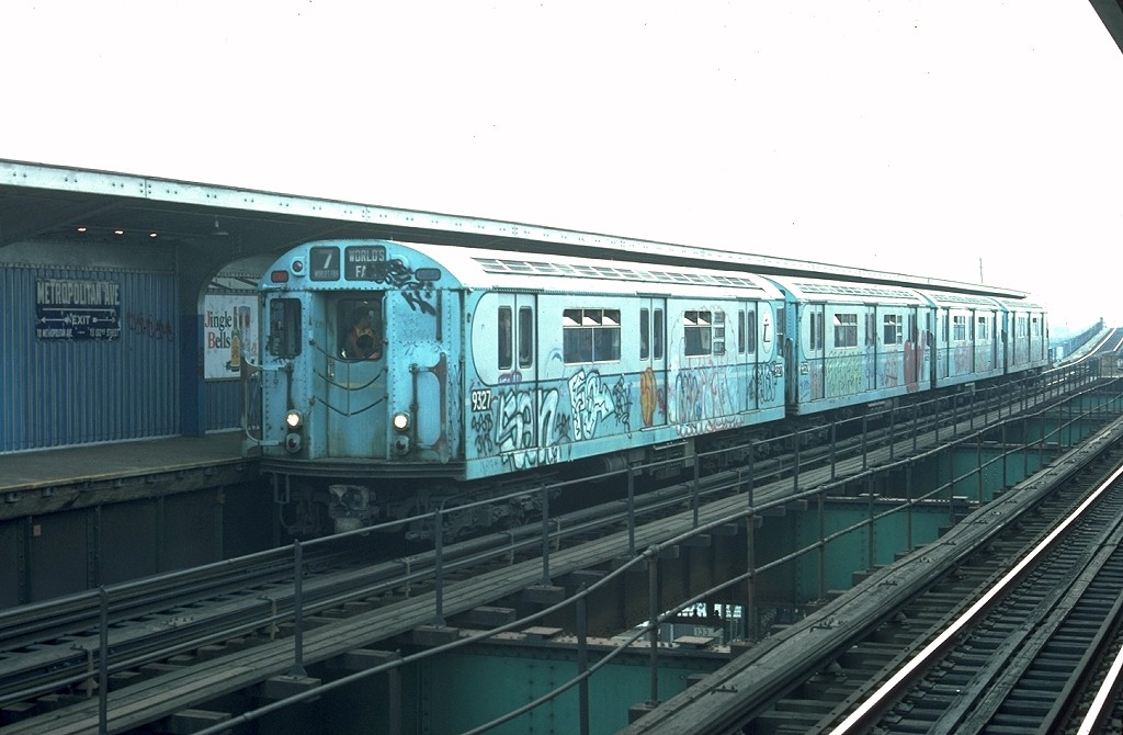 (158k, 1024x670)<br><b>Country:</b> United States<br><b>City:</b> New York<br><b>System:</b> New York City Transit<br><b>Line:</b> BMT Nassau Street/Jamaica Line<br><b>Location:</b> Metropolitan Avenue (Demolished) <br><b>Route:</b> Fan Trip<br><b>Car:</b> R-33 World's Fair (St. Louis, 1963-64) 9327 <br><b>Photo by:</b> Joe Testagrose<br><b>Date:</b> 11/27/1976<br><b>Viewed (this week/total):</b> 6 / 7326