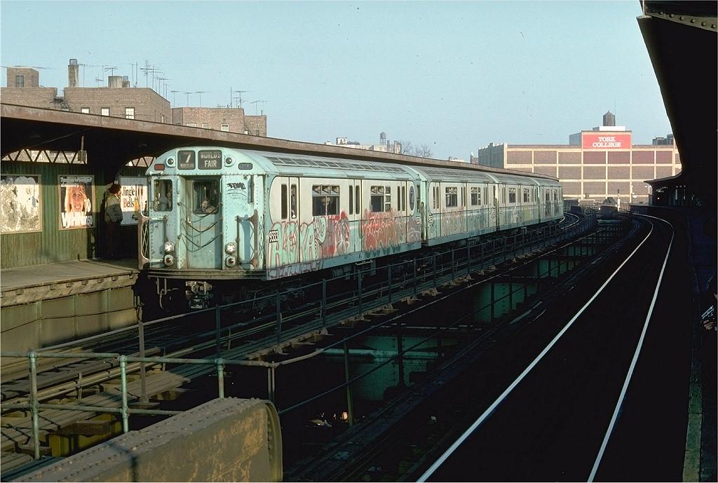 (203k, 1024x689)<br><b>Country:</b> United States<br><b>City:</b> New York<br><b>System:</b> New York City Transit<br><b>Line:</b> BMT Nassau Street/Jamaica Line<br><b>Location:</b> Sutphin Boulevard (Demolished) <br><b>Route:</b> Fan Trip<br><b>Car:</b> R-33 World's Fair (St. Louis, 1963-64) 9333 <br><b>Photo by:</b> Doug Grotjahn<br><b>Collection of:</b> Joe Testagrose<br><b>Date:</b> 11/27/1976<br><b>Viewed (this week/total):</b> 2 / 4843