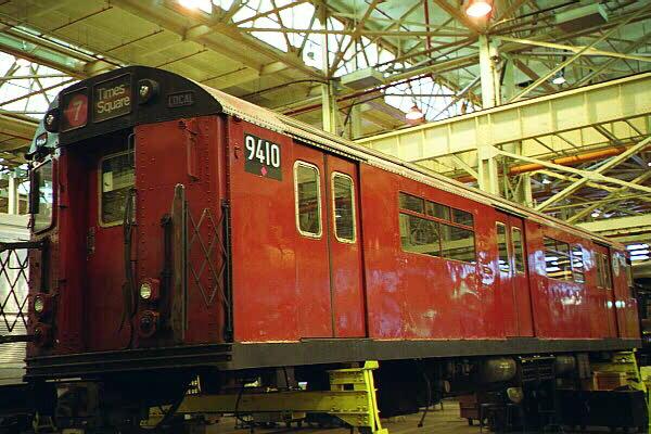(129k, 600x400)<br><b>Country:</b> United States<br><b>City:</b> New York<br><b>System:</b> New York City Transit<br><b>Location:</b> Coney Island Shop/Overhaul & Repair Shop<br><b>Car:</b> R-36 World's Fair (St. Louis, 1963-64) 9410 <br><b>Photo by:</b> Sidney Keyles<br><b>Date:</b> 5/22/1999<br><b>Notes:</b> Mate is outside on museum track<br><b>Viewed (this week/total):</b> 0 / 6786