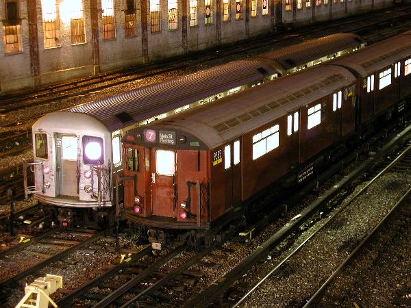 (199k, 600x450)<br><b>Country:</b> United States<br><b>City:</b> New York<br><b>System:</b> New York City Transit<br><b>Location:</b> Corona Yard<br><b>Car:</b> R-36 World's Fair (St. Louis, 1963-64) 9585 <br><b>Photo by:</b> Trevor Logan<br><b>Date:</b> 2/15/2002<br><b>Notes:</b> With R-62A #2155<br><b>Viewed (this week/total):</b> 5 / 3547
