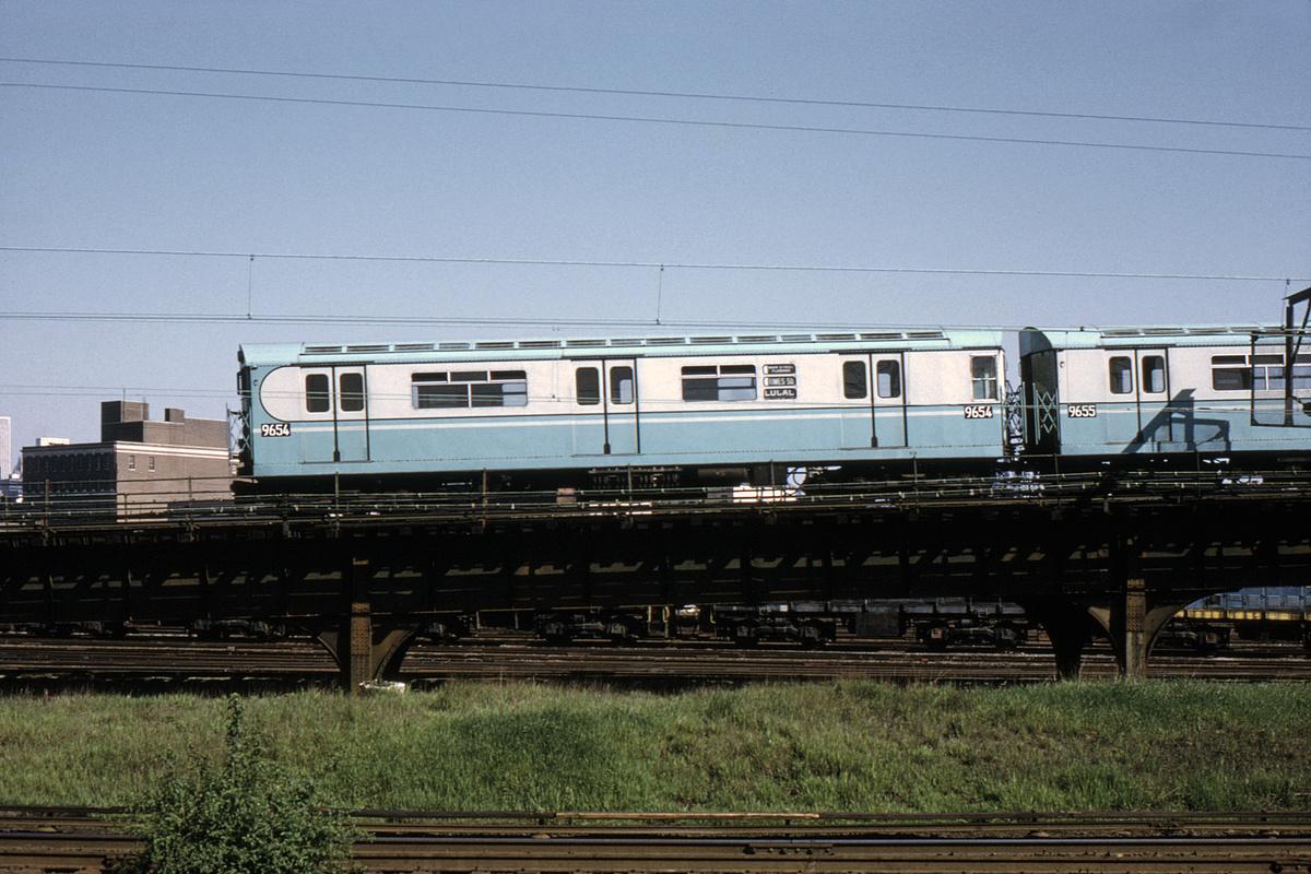 (317k, 1024x683)<br><b>Country:</b> United States<br><b>City:</b> New York<br><b>System:</b> New York City Transit<br><b>Line:</b> IRT Flushing Line<br><b>Location:</b> Viaduct approach east of Hunterspoint Ave. <br><b>Route:</b> 7<br><b>Car:</b> R-36 World's Fair (St. Louis, 1963-64) 9654 <br><b>Photo by:</b> Steve Hoskins<br><b>Collection of:</b> David Pirmann<br><b>Date:</b> 6/1973<br><b>Notes:</b> Viewed from Hunterspoint LIRR station<br><b>Viewed (this week/total):</b> 2 / 7102