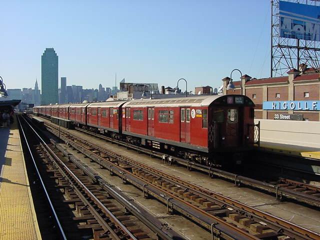 (60k, 640x480)<br><b>Country:</b> United States<br><b>City:</b> New York<br><b>System:</b> New York City Transit<br><b>Line:</b> IRT Flushing Line<br><b>Location:</b> 33rd Street/Rawson Street <br><b>Route:</b> 7<br><b>Car:</b> R-36 World's Fair (St. Louis, 1963-64) 9704 <br><b>Photo by:</b> Salaam Allah<br><b>Date:</b> 9/17/2002<br><b>Viewed (this week/total):</b> 0 / 3288