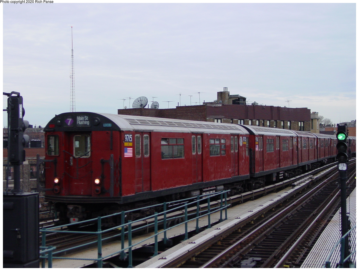 (69k, 820x620)<br><b>Country:</b> United States<br><b>City:</b> New York<br><b>System:</b> New York City Transit<br><b>Line:</b> IRT Flushing Line<br><b>Location:</b> 61st Street/Woodside <br><b>Route:</b> 7<br><b>Car:</b> R-36 World's Fair (St. Louis, 1963-64) 9715 <br><b>Photo by:</b> Richard Panse<br><b>Date:</b> 1/23/2002<br><b>Viewed (this week/total):</b> 2 / 3207