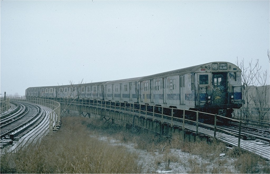 (220k, 1024x661)<br><b>Country:</b> United States<br><b>City:</b> New York<br><b>System:</b> New York City Transit<br><b>Line:</b> BMT West End Line<br><b>Location:</b> Bay 50th Street <br><b>Route:</b> B<br><b>Car:</b> R-27 (St. Louis, 1960)  8055 <br><b>Photo by:</b> Steve Zabel<br><b>Collection of:</b> Joe Testagrose<br><b>Date:</b> 12/9/1981<br><b>Viewed (this week/total):</b> 0 / 5617